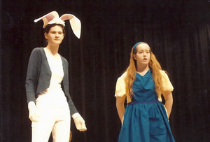 Kayla DeMaria as White Rabbit and Meghan Harrington as Alice