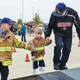 Helping a little girl at the Fire Safety Palooza
