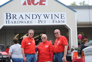 Owners Chris Drennen Larry Drennen Sr and Larry Drennen Jr celebrate the grand re-opening of Brandywine Ace Pet and Farm