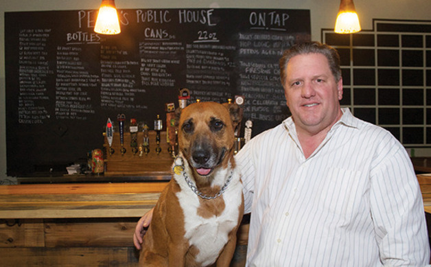 Main_image_craig-scharton-and-his-dog-peeve-for-whom-peeves-public-house-is-namedcmyk