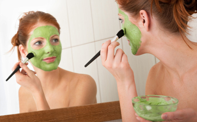 Main_image_woman-putting-on-green-face-mask-home