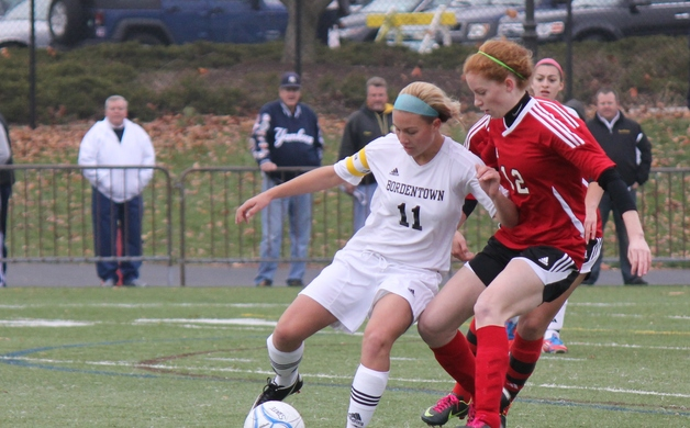 Alexis McTamney battles with a Glen Rock player during the state final on Dec 2 2012