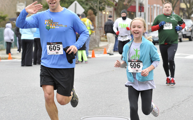Brian Wheeler and daughter Emily run together