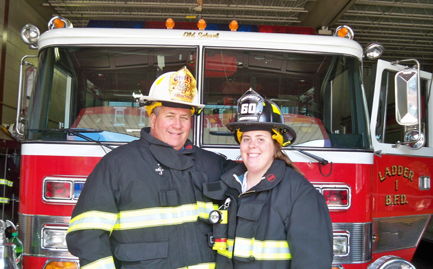 Nicole Walls and her father John stand in their firefighting gear at Consolidated Fire Association