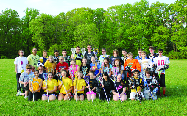 The Bordentown Lacrosse Club poses before a practice on May 9