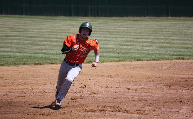 Tom Walters rounds second base during a game against Lawrence on June 15 2013 at Gilder Park Staff photo by Samantha Sciarrotta