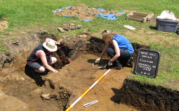 Monmouth University students excavate one of the test pits in the 2013 archeological dig