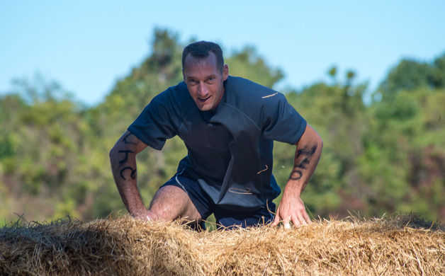 Lance Kovac ascends the hay bales