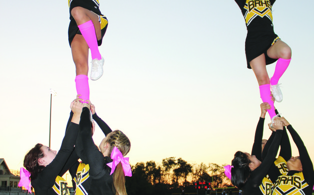 At left Alicia Saranin Gina Capone and Katelyn Connelly hold up Anngie Licarte For the right stunt AJ Licarte Cierra Edwards and Rebecca Gardner hoist Steffi Agbulos Staff photo by Samantha Sciarrotta