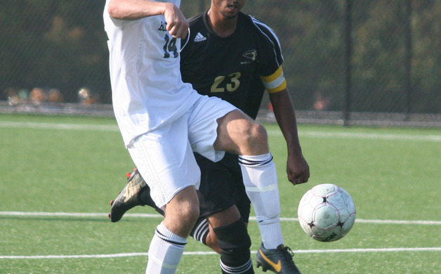 Robert DiPierro races with a Burlington Township player during a 2-0 win on Oct 4 2013 Staff photo by Samantha Sciarrotta