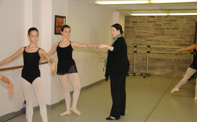 Alisha Cardenas works on perfecting Frappes at the barre with Sophie LeVach and Christina Dunnington  at Central NJ Ballet Theatre on Nov 14 2013