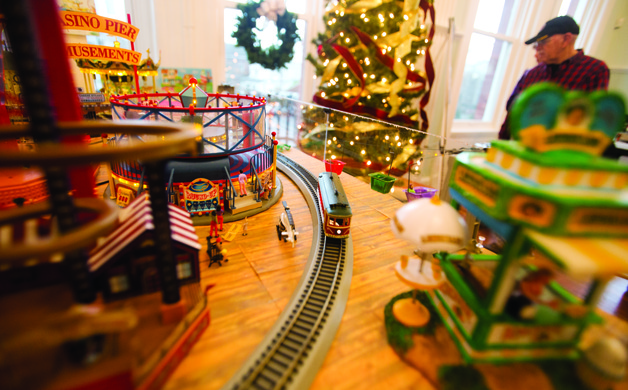 A train chugs through a model of the Seaside boardwalk at the annual train display at Old City Hall