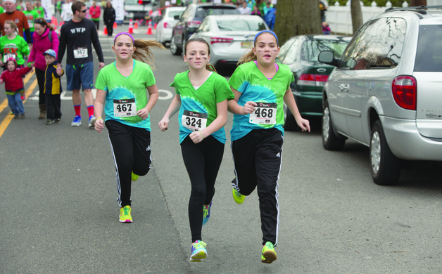 Collette Vanhise Isabel Lukach and Julianna Vanhise jog down the street