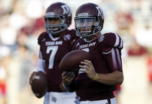 Kenny Hill posted solid numbers in limited action behind Heisman winner Johnny Manziel