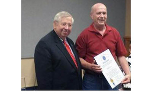 Senator Richard T Moore D-Uxbridge presented Eldridge with a citation from the State House