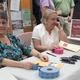 Pauline Krajcik and Ann Odabashian sell raffle tickets