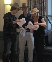 Cast members go over their scripts before rehearsal begins