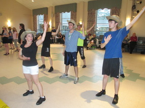 Choeographer Tammy Paulino works with the male dancers in the opening song rehearsal begins