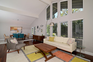 This living room reflects a softened version of mid-century modern design