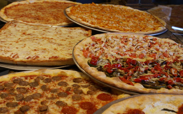 A number of pizza varieties are available at Mangia Brick Oven Pizza and Grill
