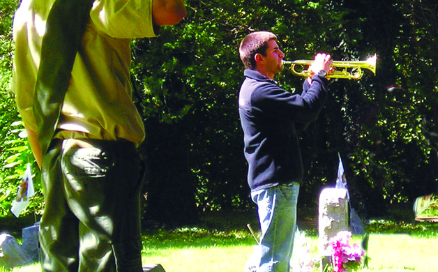 Left Matthew Nardone plays Taps at the ceremony Sept 14 2013