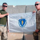 Tim Harvey of Blackstone left in Afghanistan in 2011 holds MA flag given him by State Senator Richard Moore